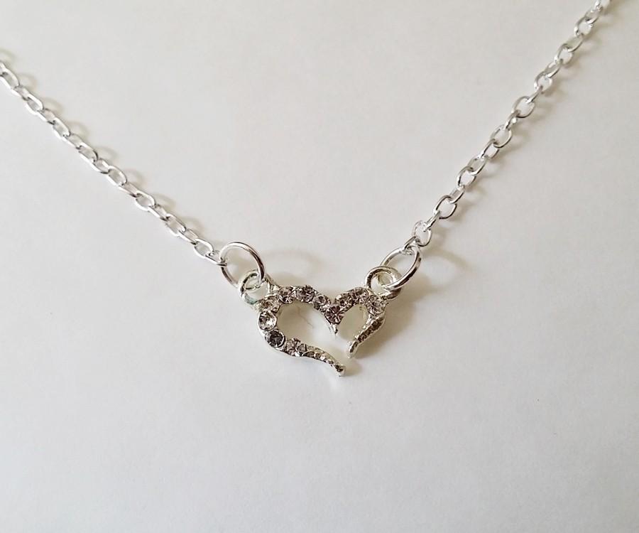 Collier avec pendentif coeur orné de strass