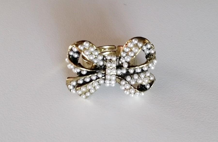 Bague noeud ornée de perles blanches