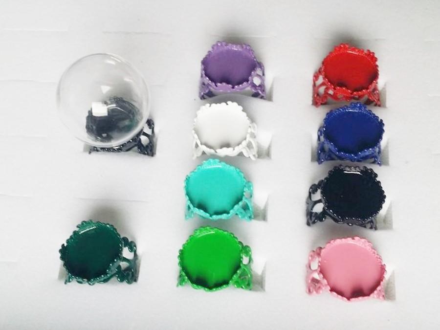 Bague globe en verre et anneau coloré