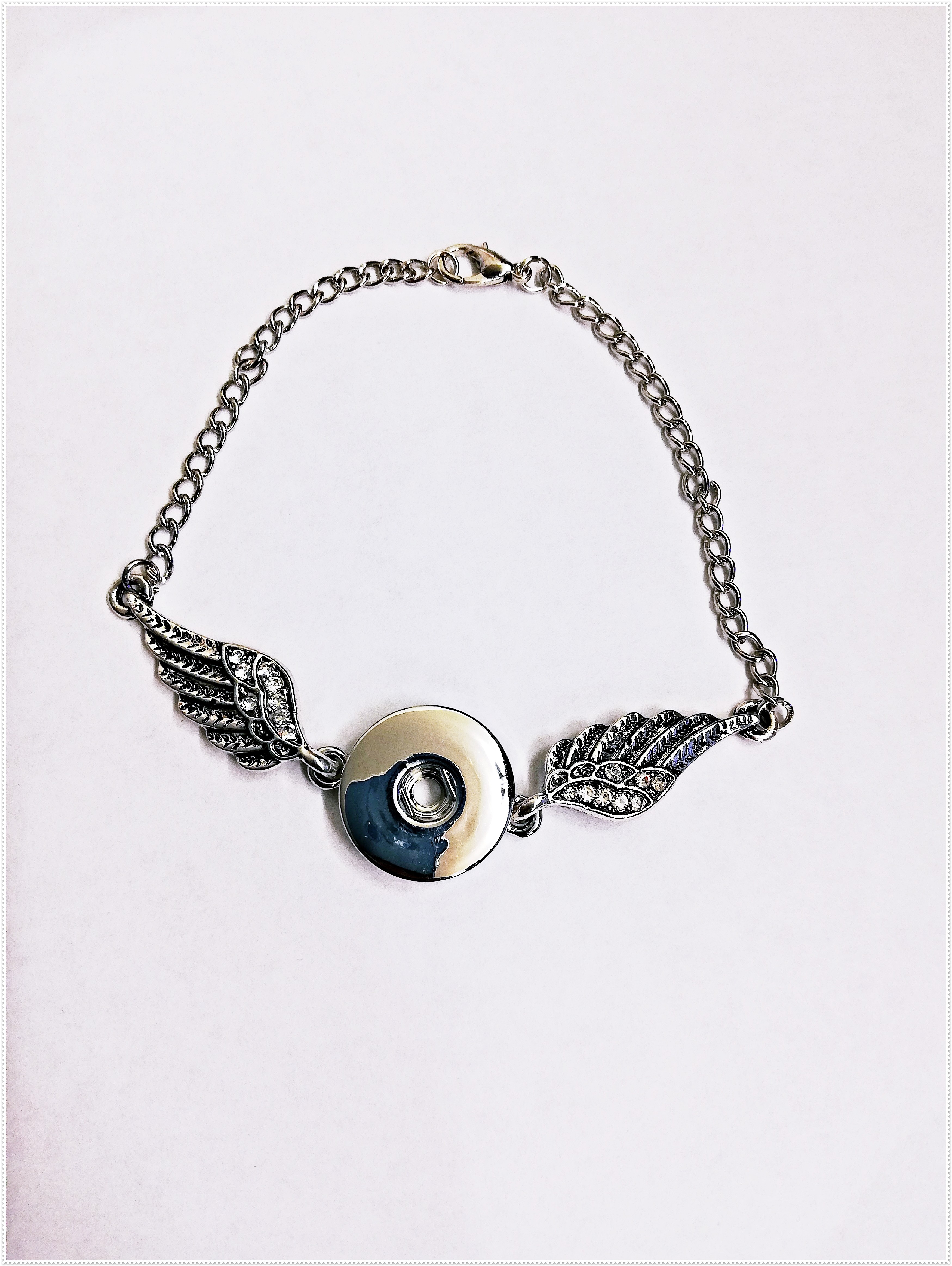 Bracelet bouton pression ailes d'ange et strass.